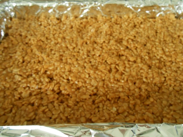 Biscoff Rice Krispies in foil lined pan